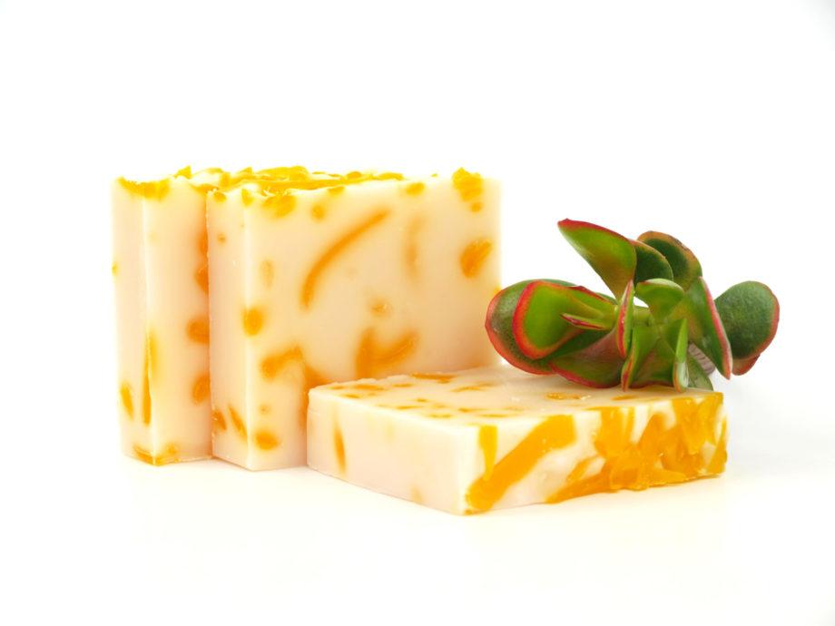 orange and cream soaps with plant