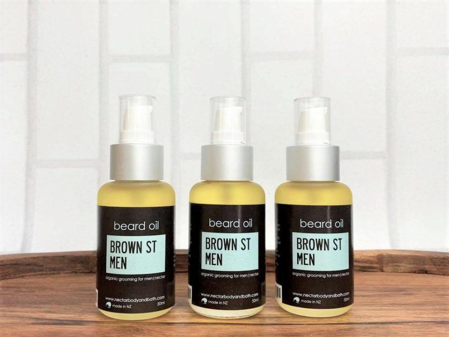 beard oil frosted bottles on wood