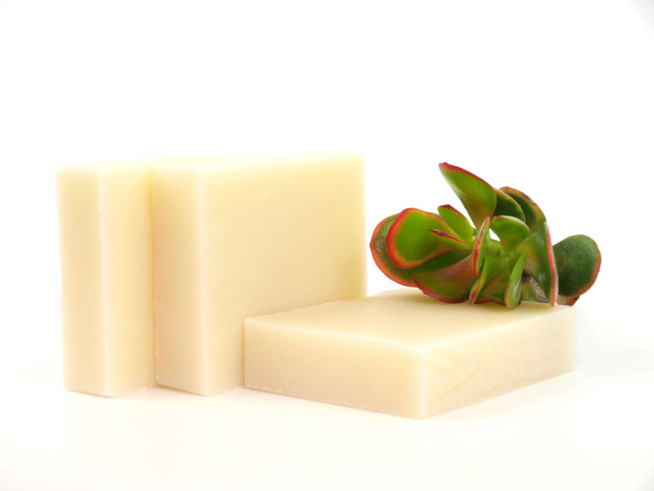 three soaps with plant