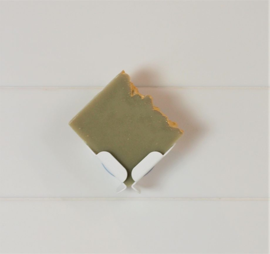 french pear soap in white block dock attached to white tiled wall