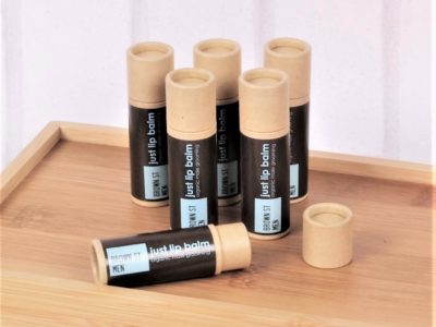 mens lip balm in kraft paper tubes on wood