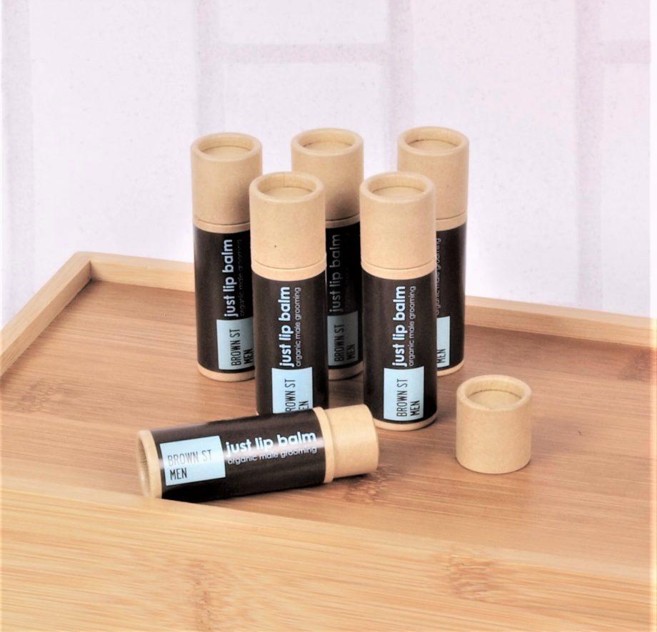 mens lip balm in kraft paper tubes on wood